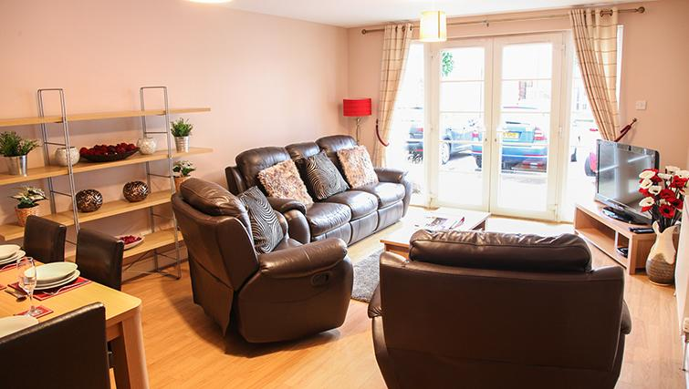 Comfortable living area at Playhouse Apartments