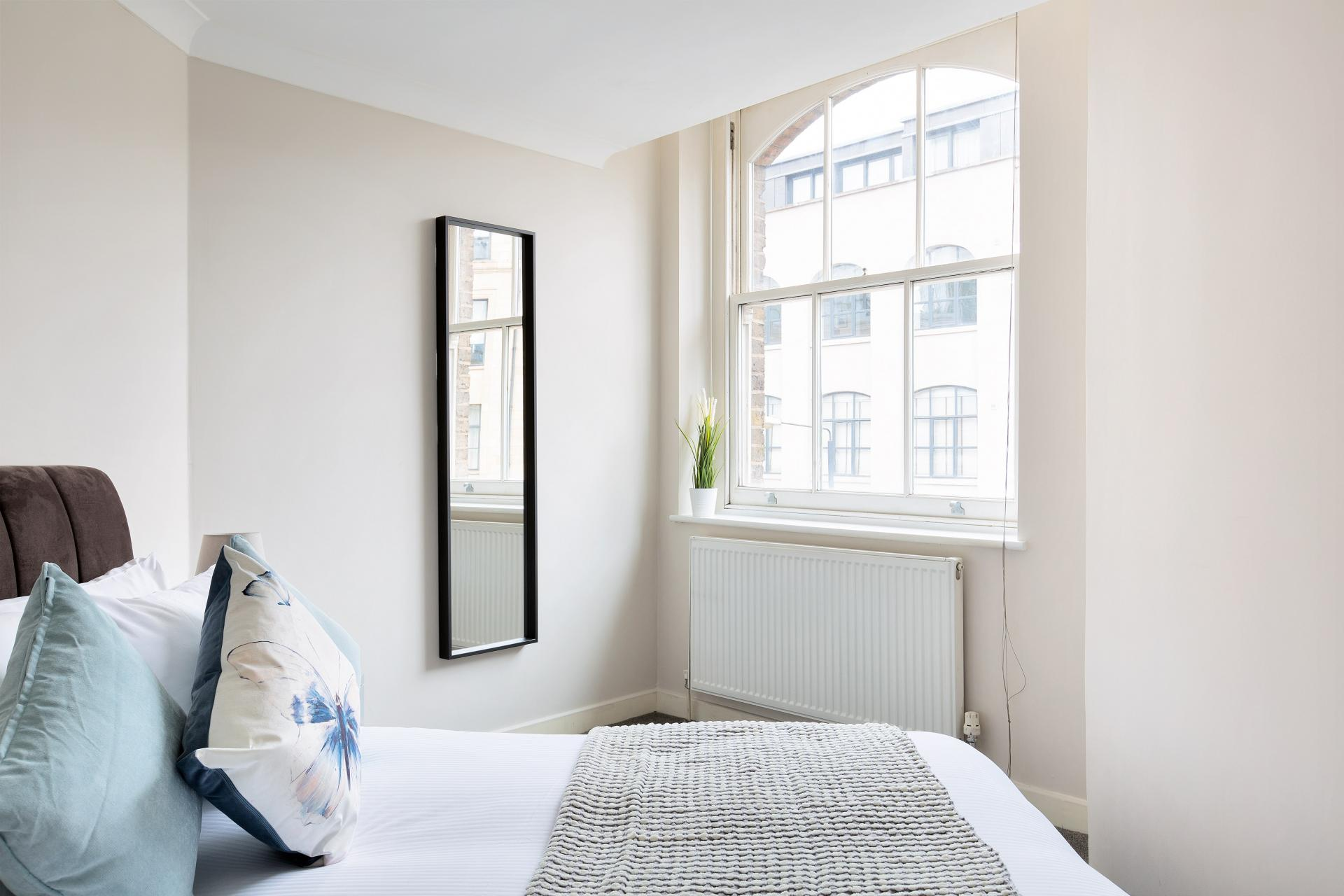 Light bedroom at Heart of Shoreditch Apartments, Whitechapel, London