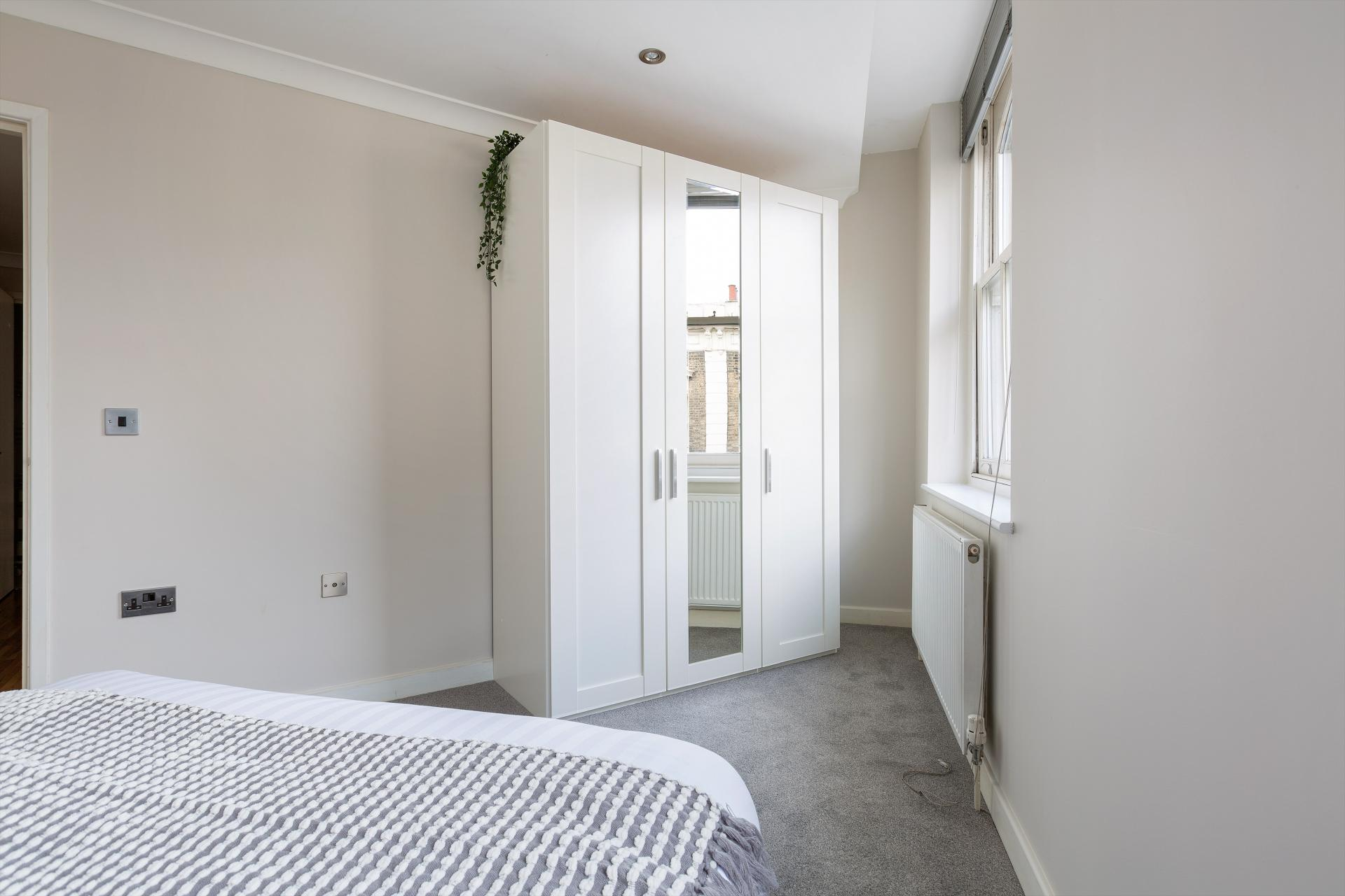 Light bedroom at Comercial Street Apartments, Whitechapel, London