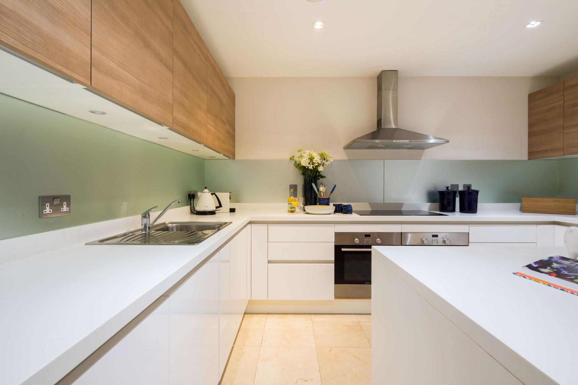 Sleek kitchen at Meritas Court Apartments, Bayswater, London