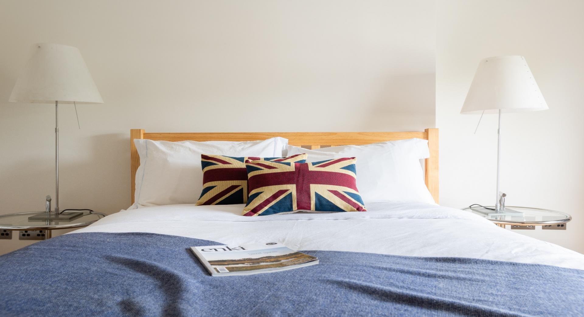 Wooden bed at Lansdowne Crescent Apartment, Holland Park, London