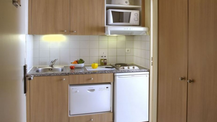 Compact kitchenette in Citadines Didot Montparnasse Apartments
