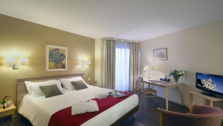 Elegant bedroom in Citadines Didot Montparnasse Apartments