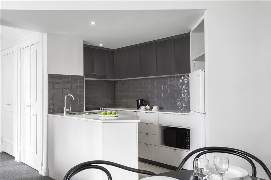 Sleek kitchen at Mantra 2 Bond Street, Centre, Sydney
