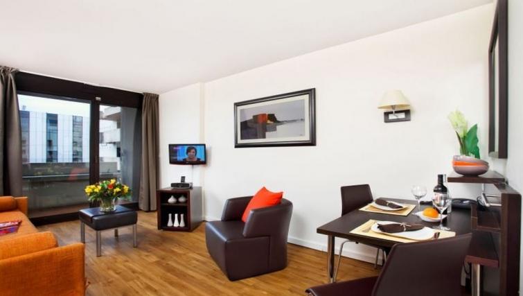 Spacious living area in Citadines La Defense Apartments