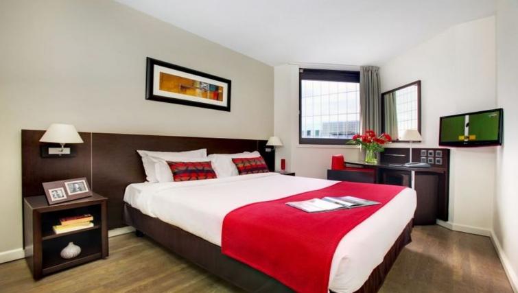 Luxury bedroom in Citadines La Defense Apartments