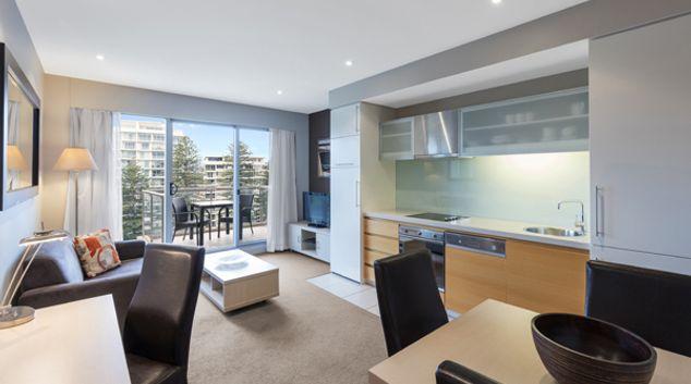 Living room at Oaks Glenelg Plaza Pier Suites