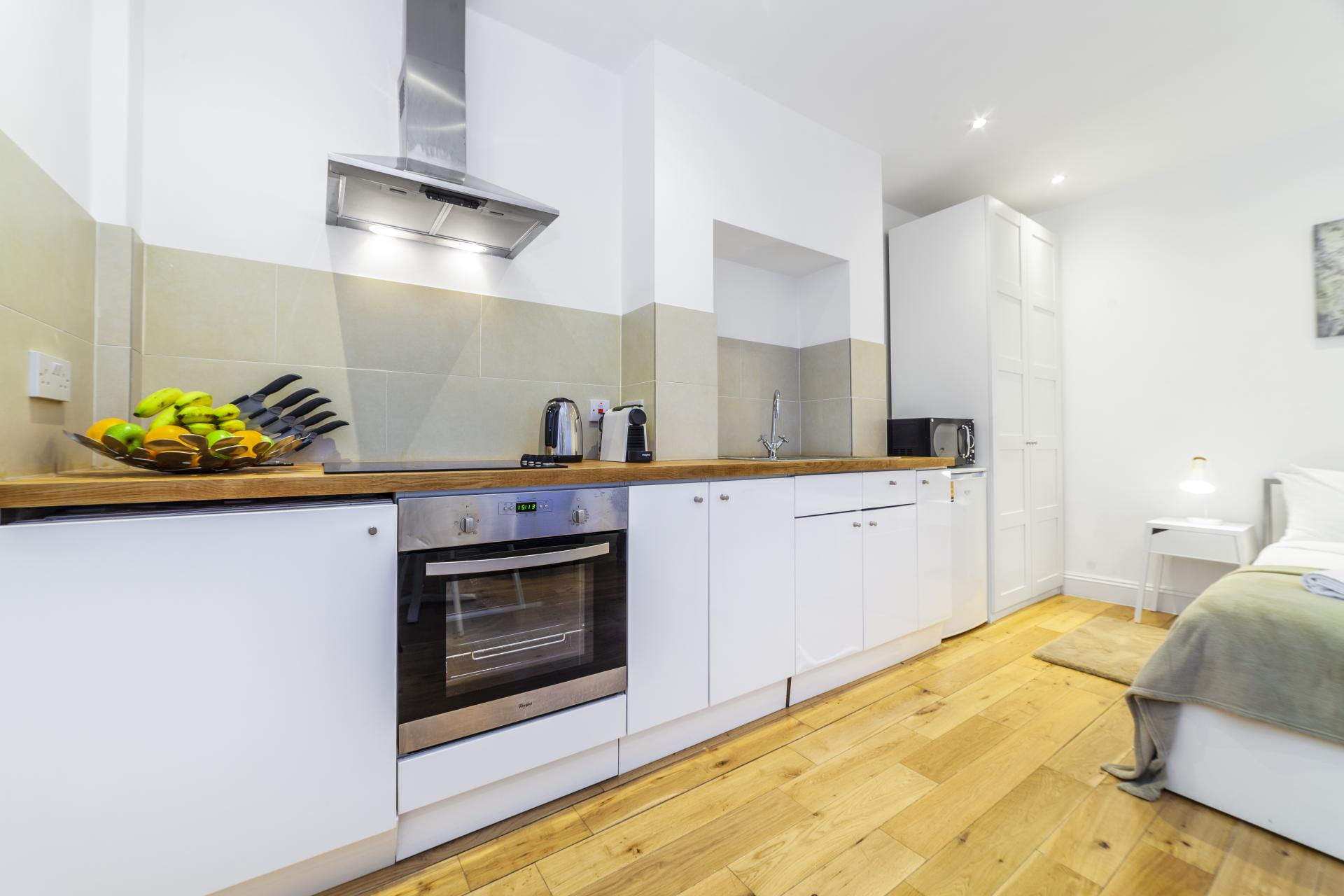 Sleek kitchen at Devonshire Terrace Apartments, Bayswater, London