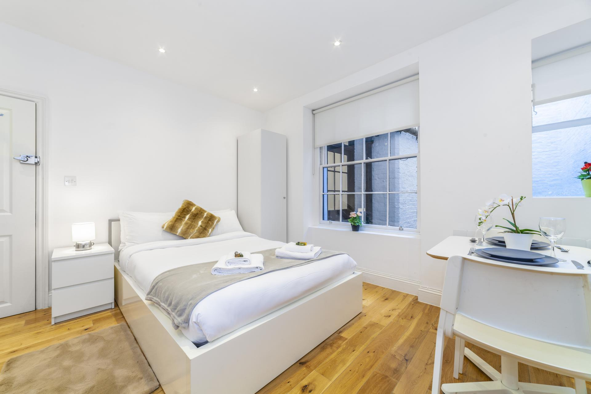 Bright bedroom at Devonshire Terrace Apartments, Bayswater, London
