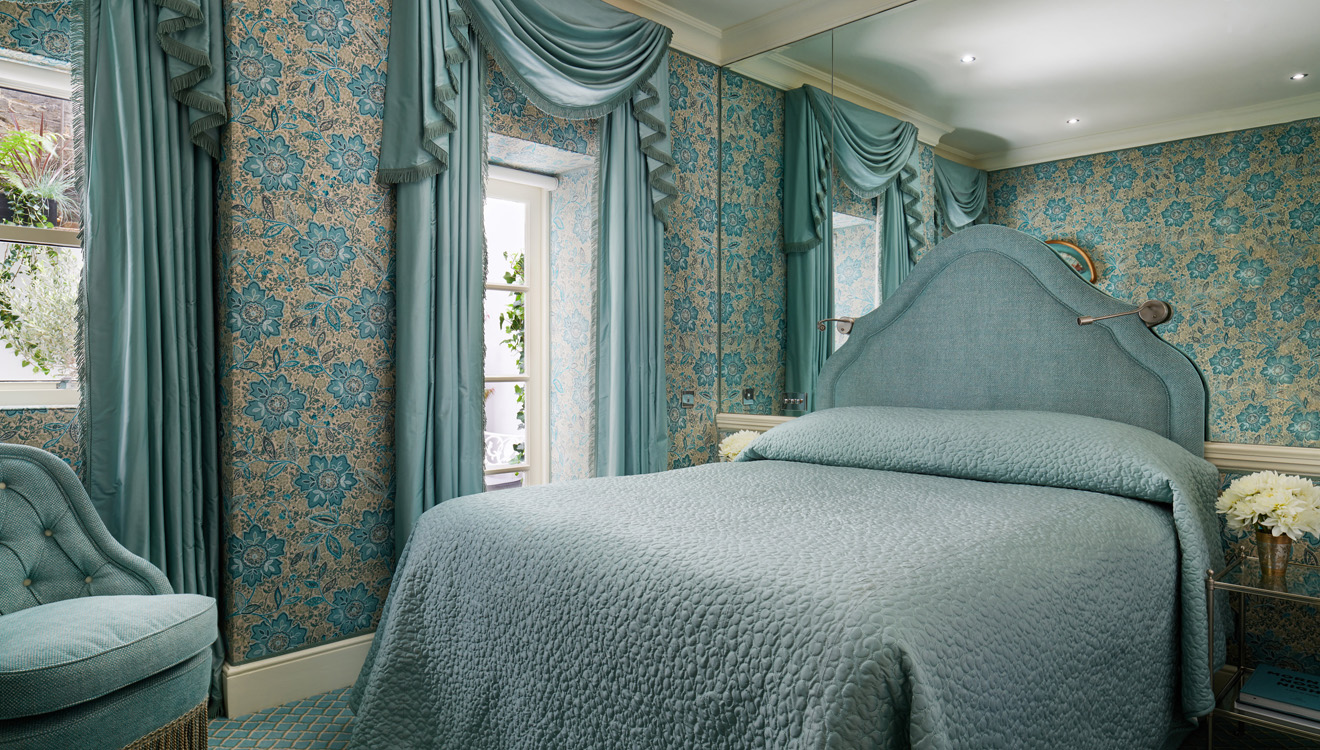 Blue bedroom at Milestone Apartments