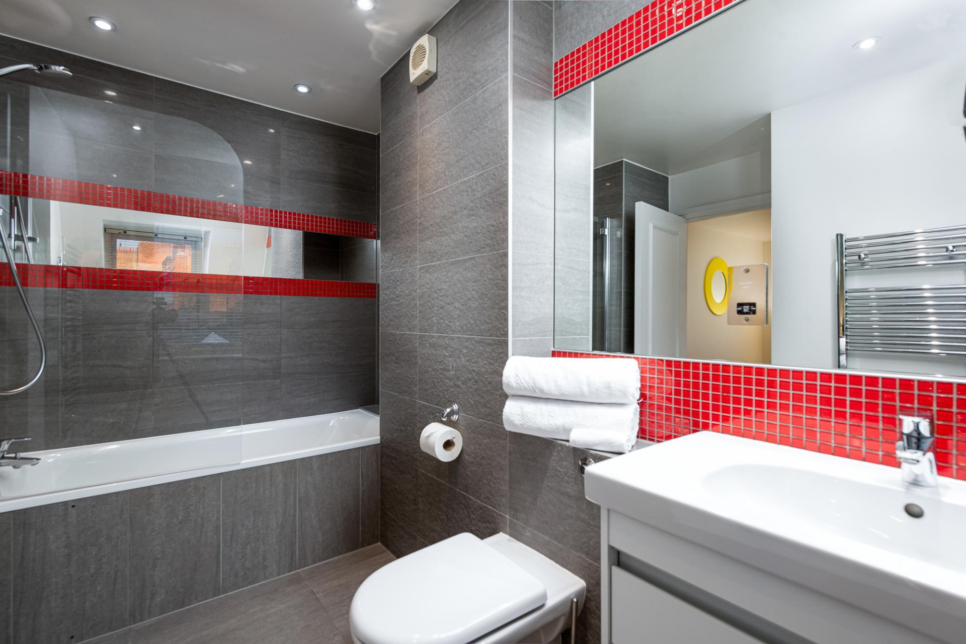 Sleek bathroom at Draycott Place Serviced Apartments, Chelsea, London