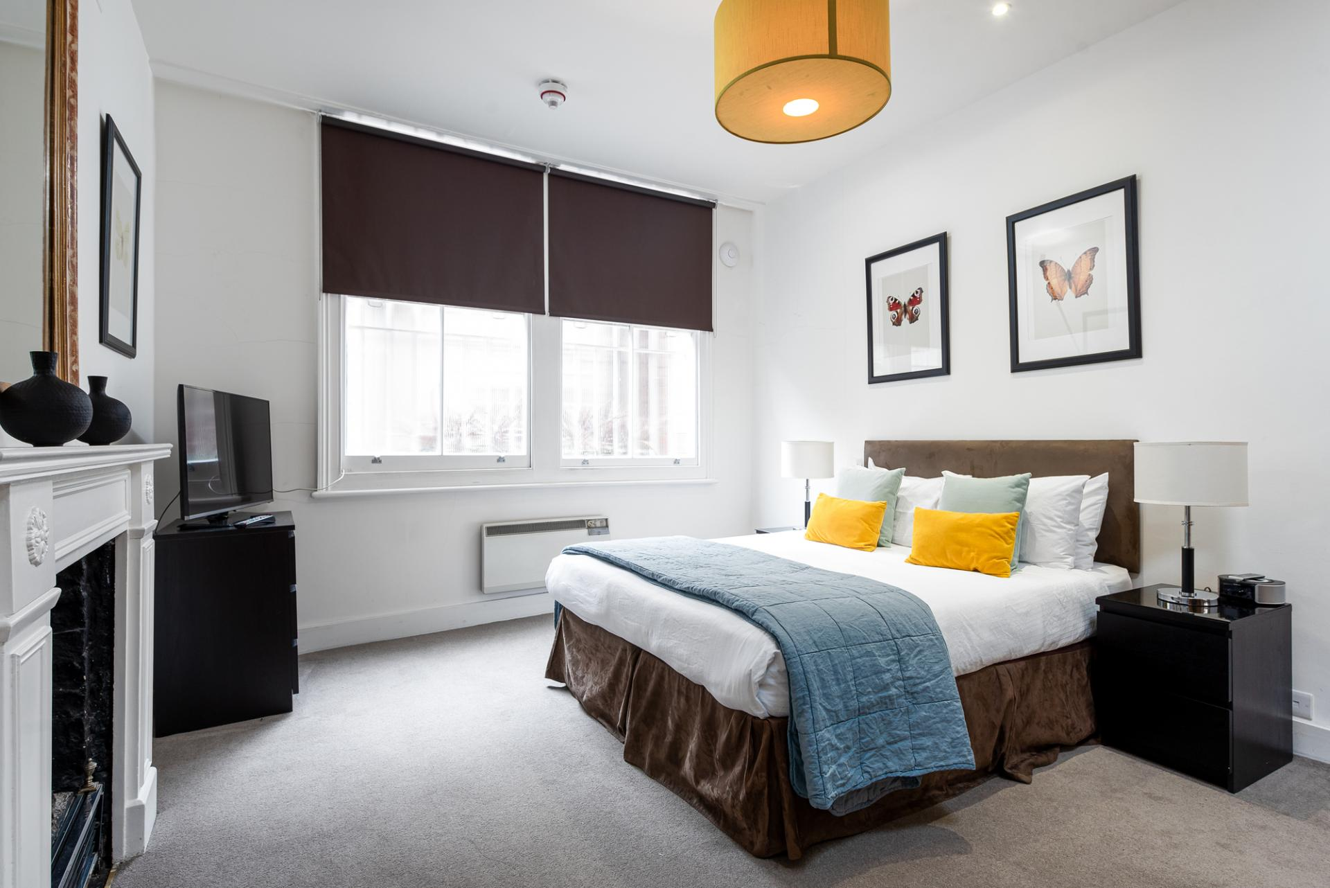 Cosy bedroom at Draycott Place Serviced Apartments, Chelsea, London