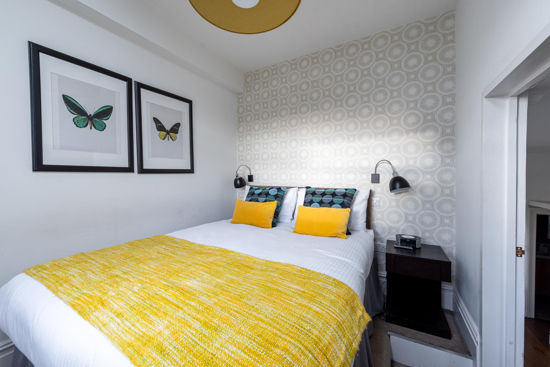 Cosy bed at Draycott Place Serviced Apartments, Chelsea, London