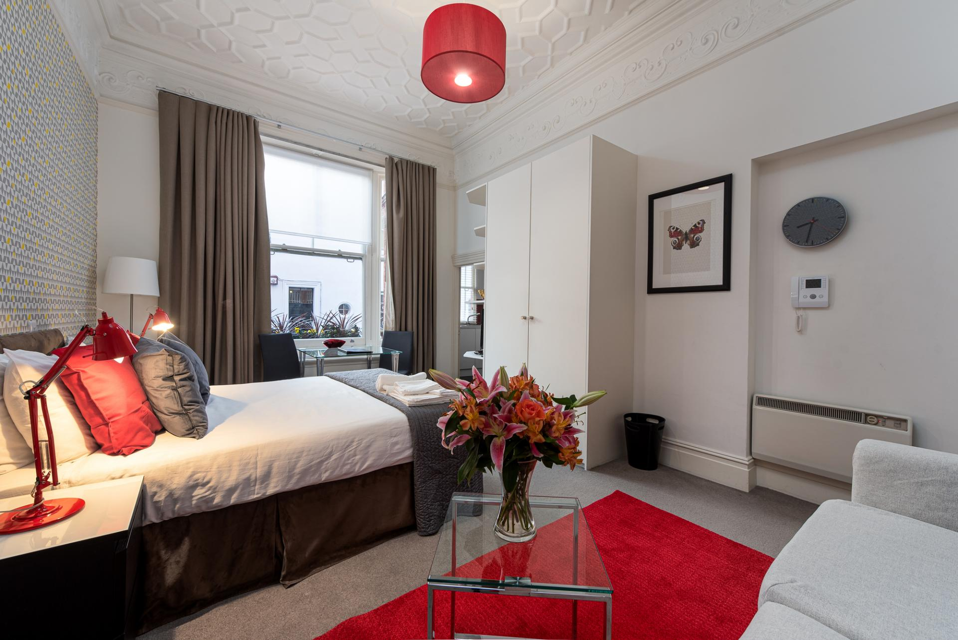 Red bedroom at Draycott Place Serviced Apartments, Chelsea, London