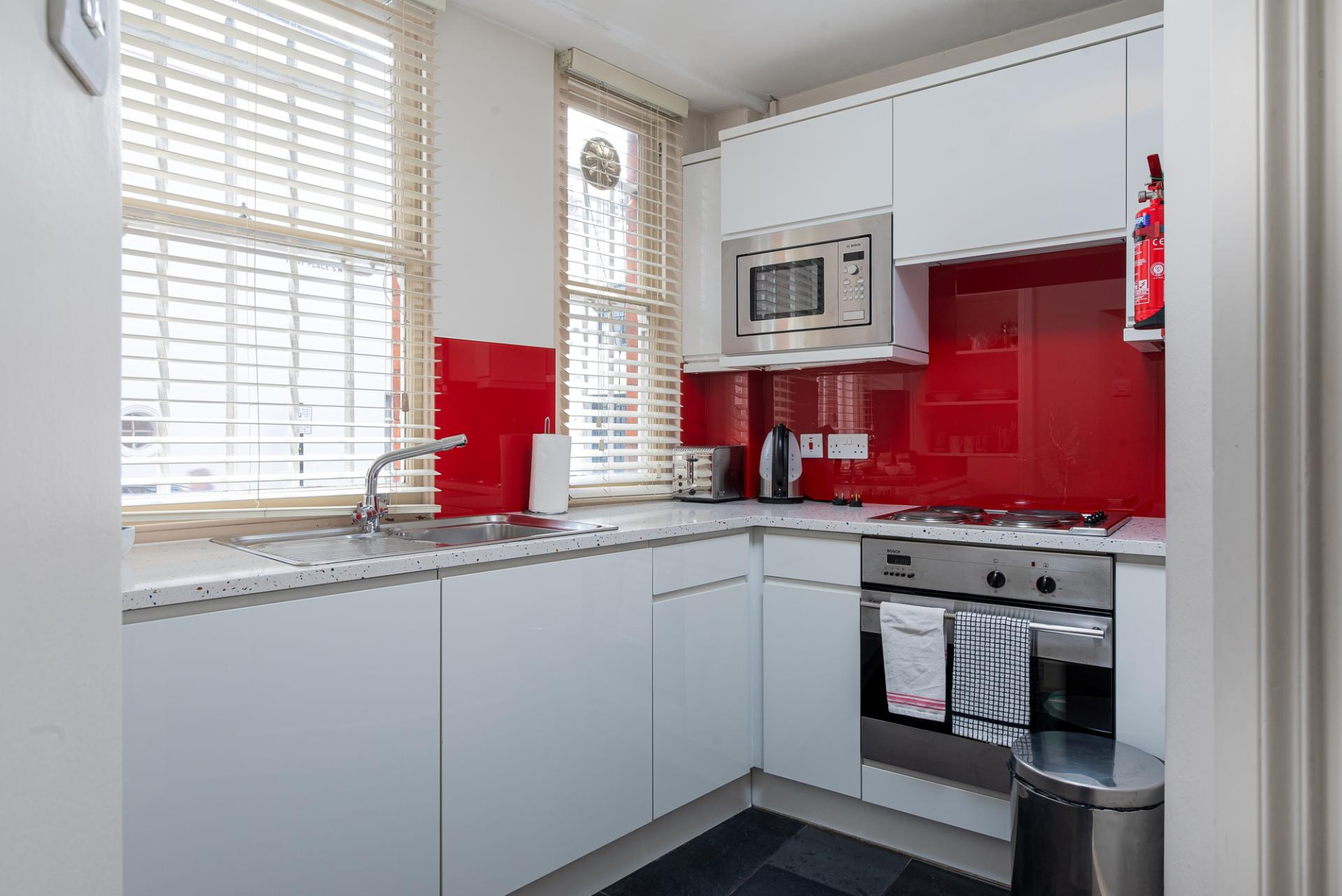 Red kitchen at Draycott Place Serviced Apartments, Chelsea, London