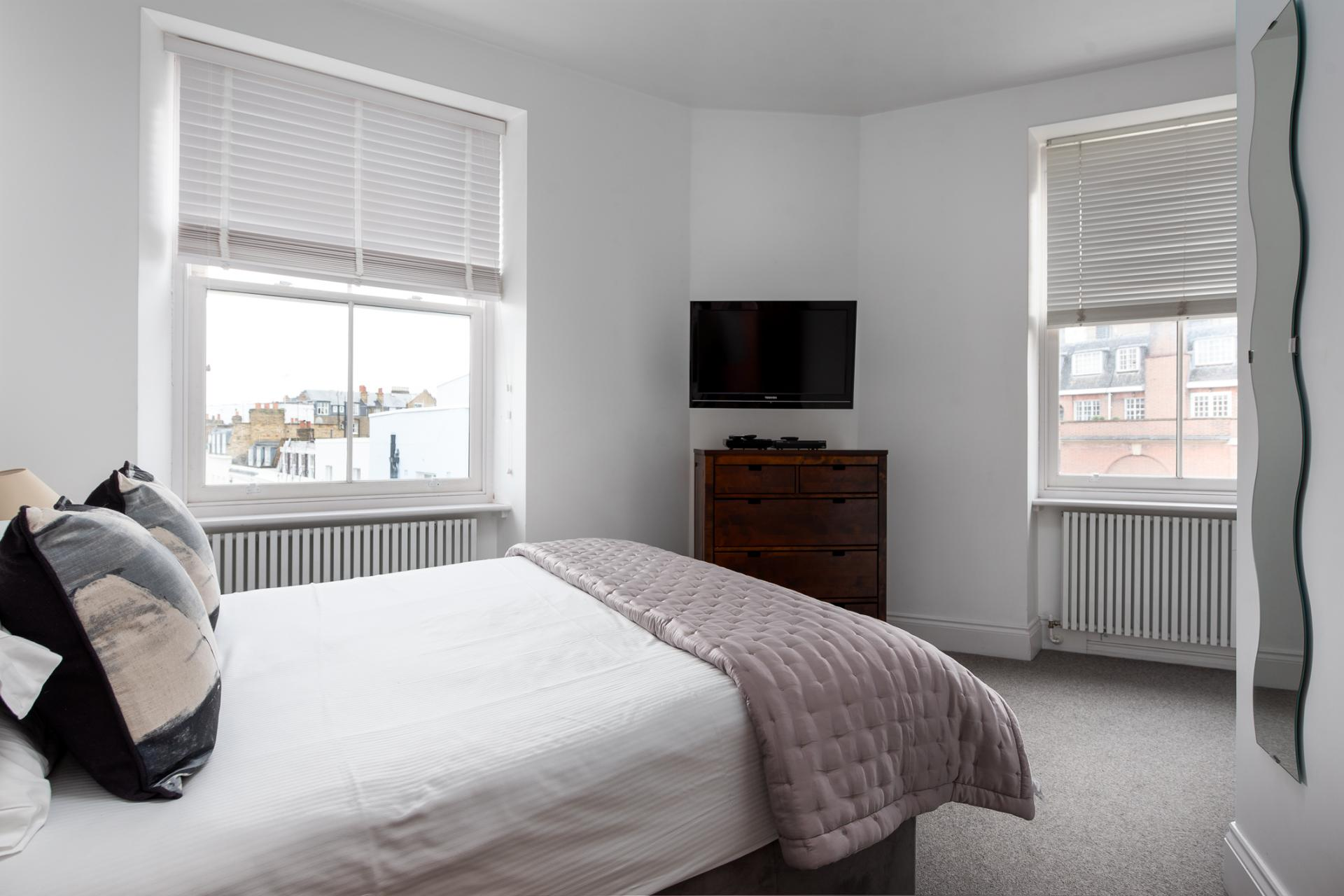 Bed at Chelsea Green Apartments, Chelsea, London