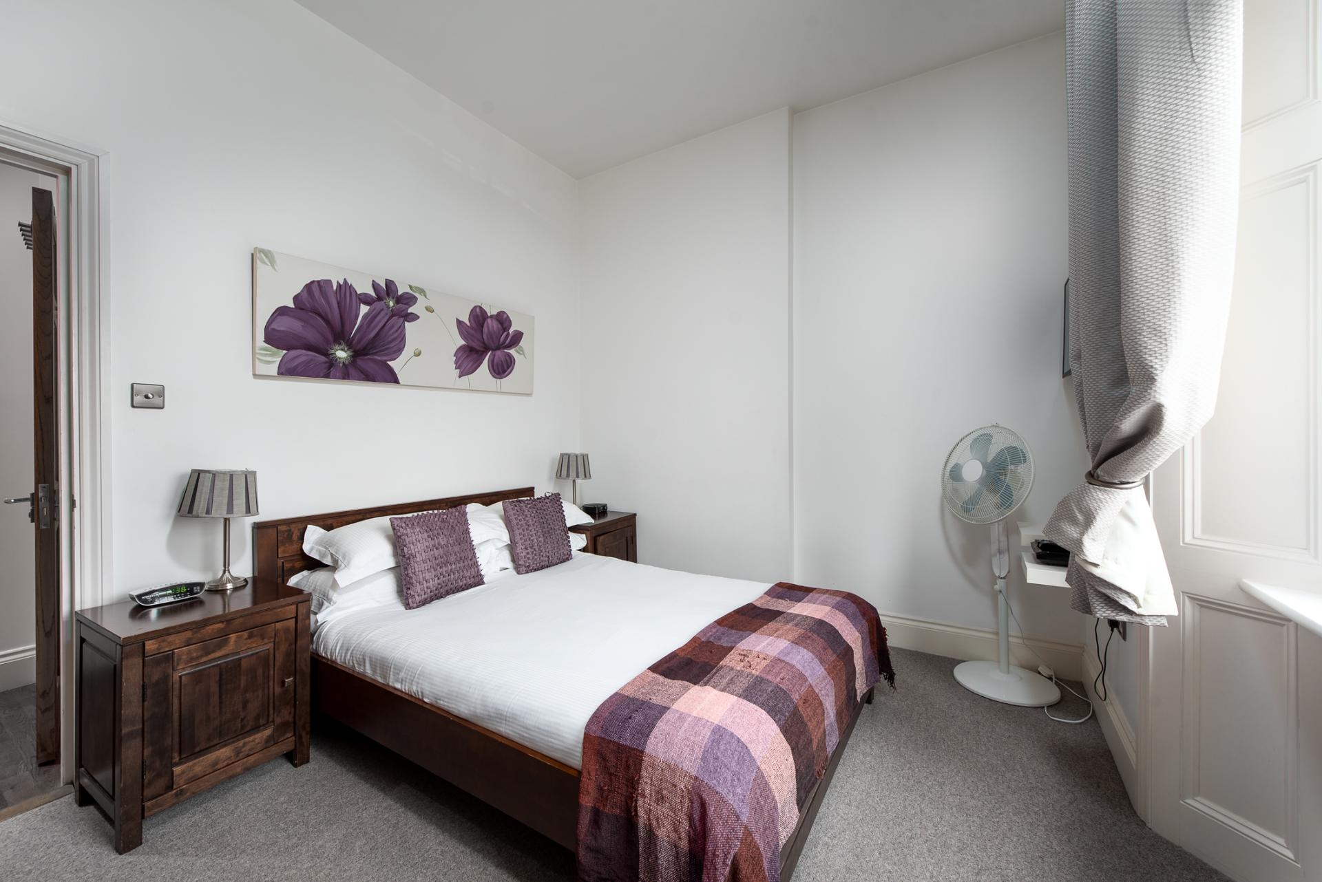 Bright bedroom at Chelsea Green Apartments, Chelsea, London