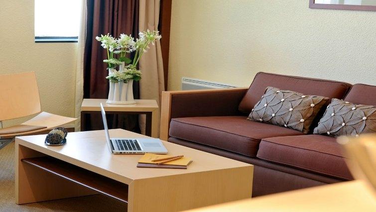 Bright living room in Adagio Toulouse Centre Ramblas