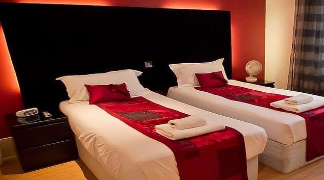 Inviting bedroom at Merchants Quarter Apartments
