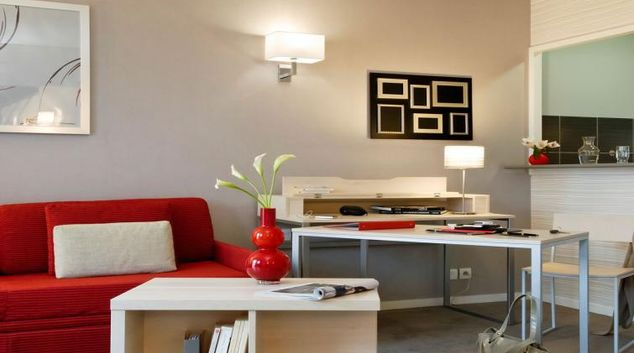 Colourful living area in Adagio Paris Montrouge