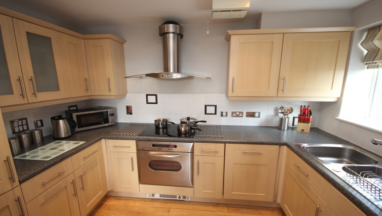 Contemporary kitchen in High Quays Apartments
