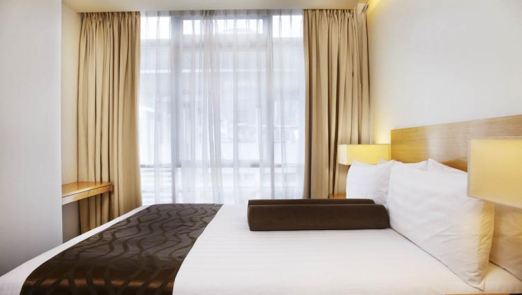 Practical bedroom at PARKROYAL Serviced Suites Kuala Lumpur