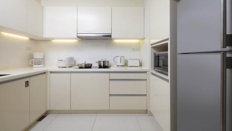 Equipped kitchen at PARKROYAL Serviced Suites Kuala Lumpur