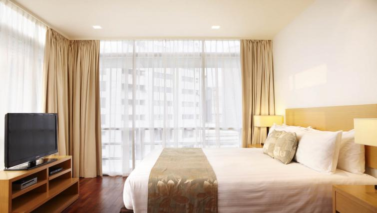 Clean bedroom at PARKROYAL Serviced Suites Kuala Lumpur