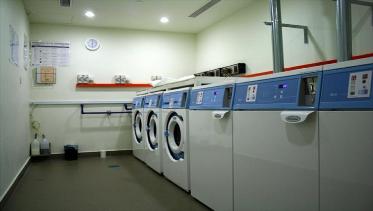 Communal laundry room at PARKROYAL Serviced Suites Kuala Lumpur