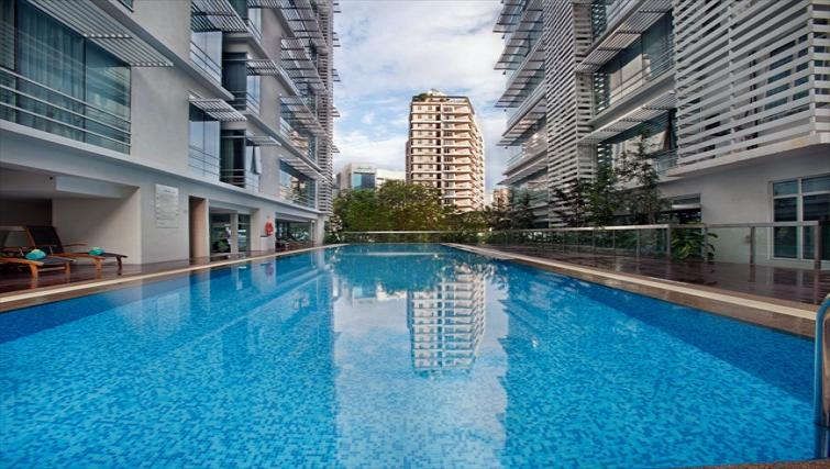 Outdoor swimming pool at PARKROYAL Serviced Suites Kuala Lumpur