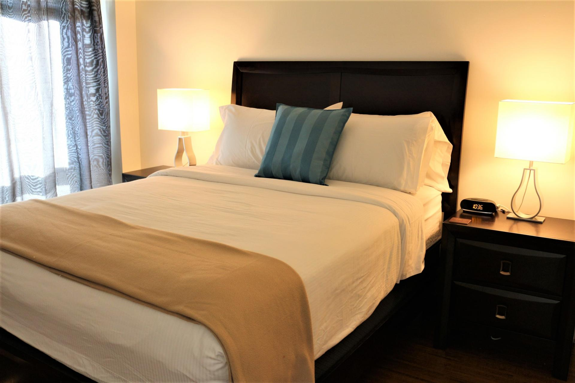 Bedding at The Mosaique Apartments, Centre, Montreal