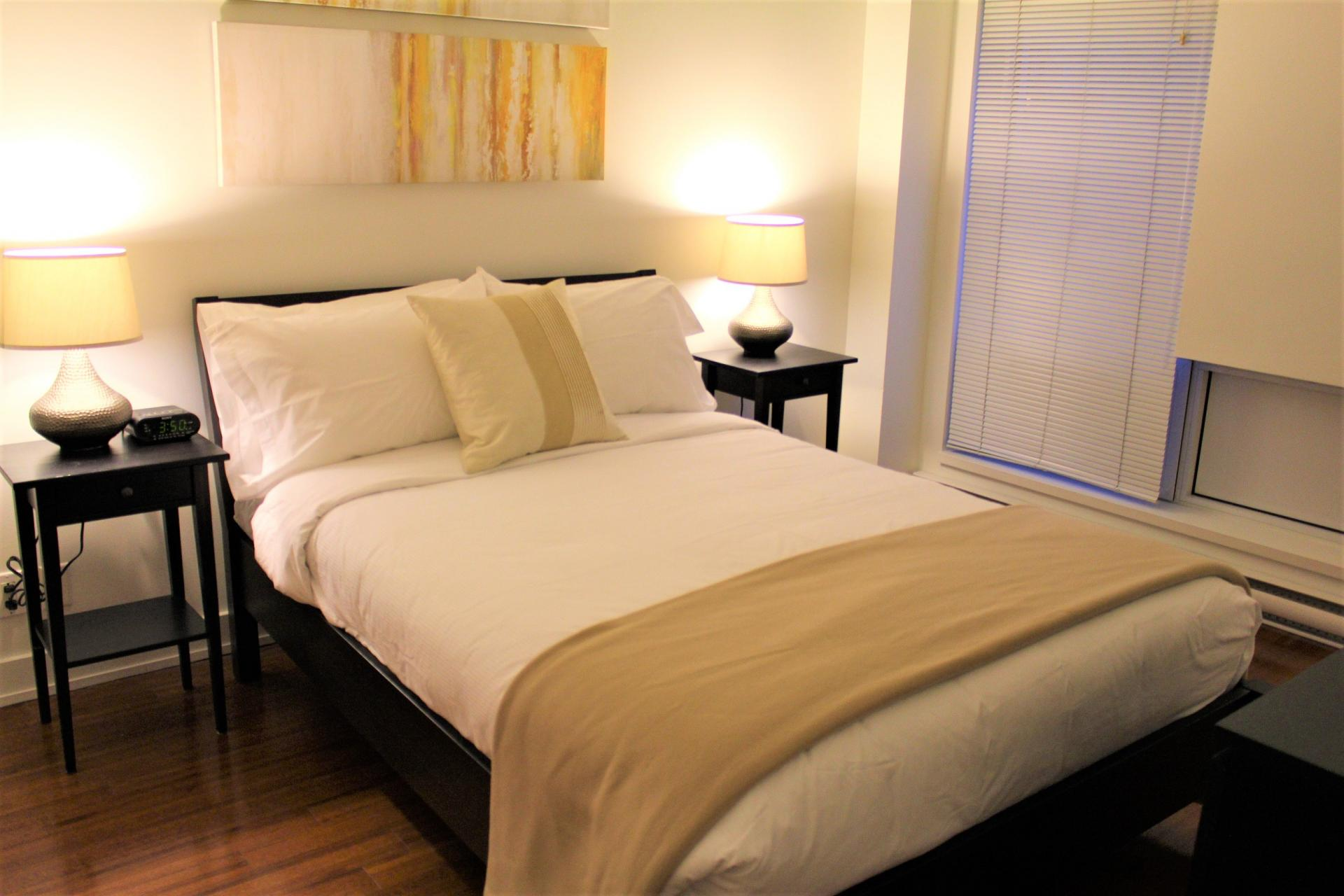 Double bed at The Mosaique Apartments, Centre, Montreal