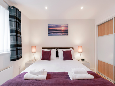 Double bed at Capitol Square Apartments