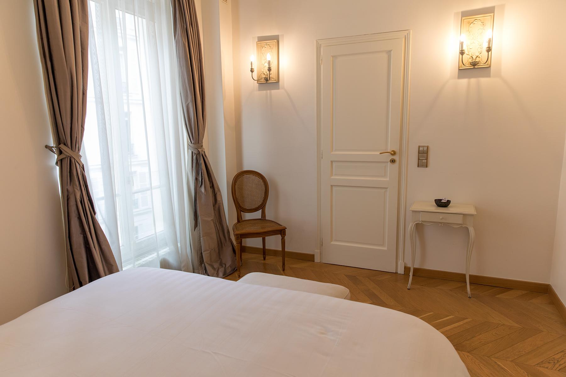 Bright bedroom at Apartment Monceau Chic, 9th Arr, Paris