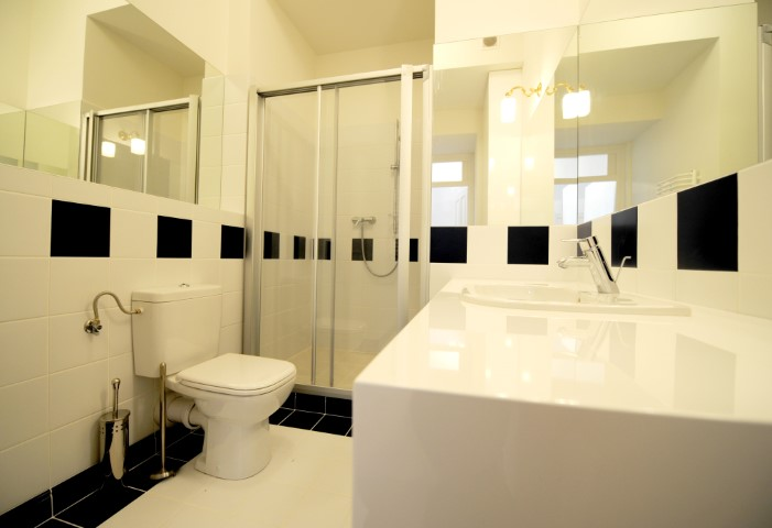 Spacious bathroom at Krakow Old Town Apartments