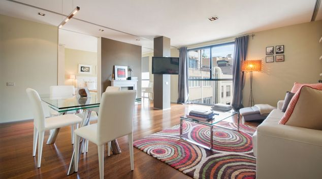 Living area at 99 Paseo De Gracia Apartments, Eixample, Barcelona
