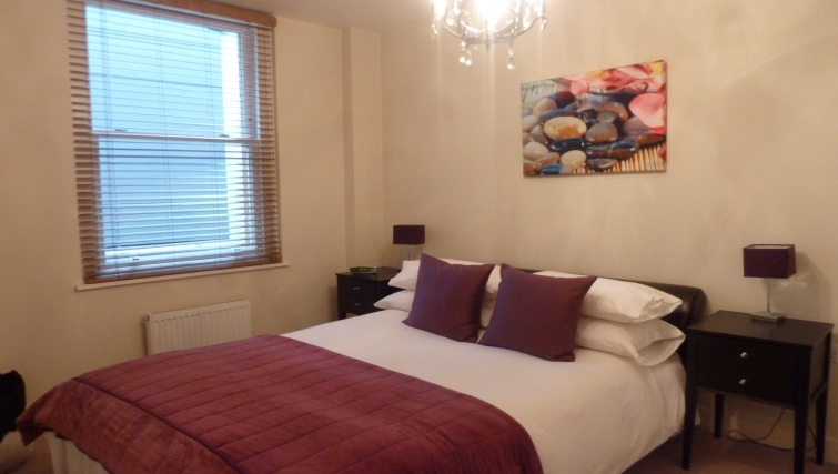Cosy bedroom in South Molton Street Apartments