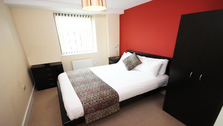 Bed at Merchants Quay Apartments