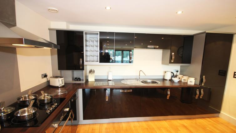 Equipped kitchen at Merchants Quay Apartments
