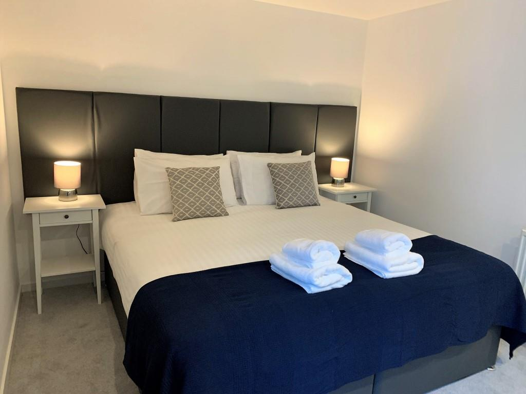 Cosy bedroom at Tolbooth Apartments