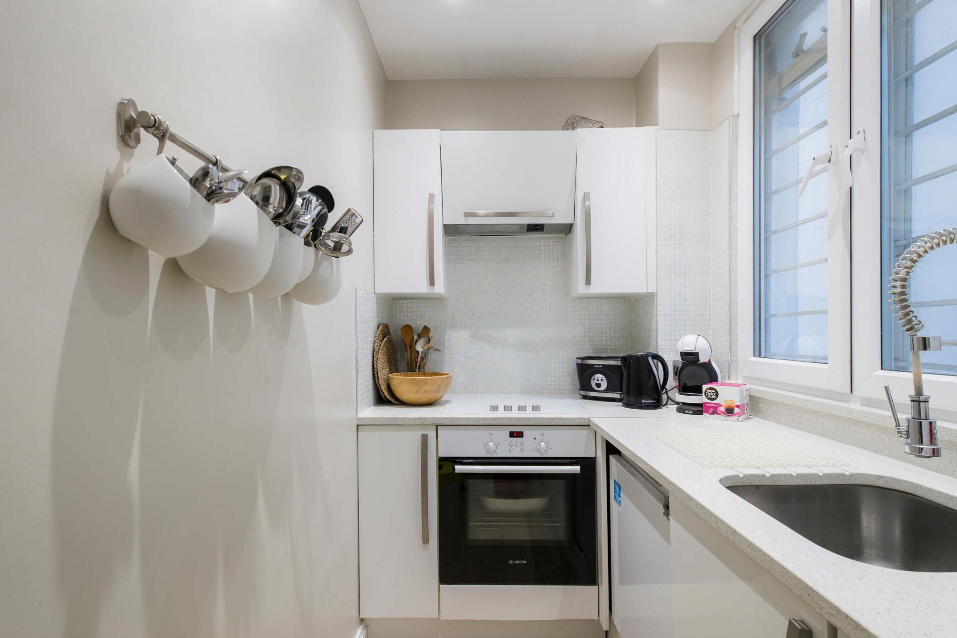 Modern kitchen at Westbourne Gardens Apartment, Bayswater, London