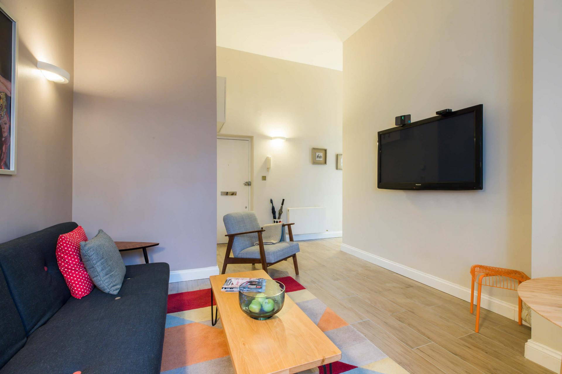 Living space at Westbourne Gardens Apartment, Bayswater, London