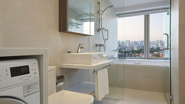 Bath and shower at PARKROYAL Serviced Suites Singapore