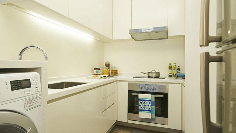 Washer dryer and kitchen at PARKROYAL Serviced Suites Singapore