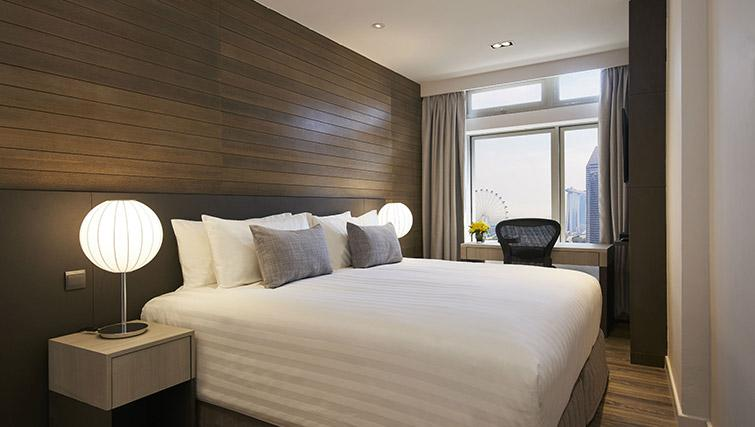King bed at PARKROYAL Serviced Suites Singapore