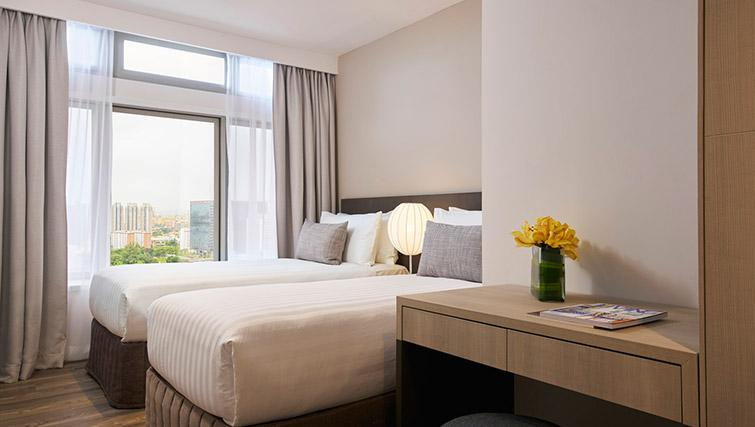 Twin beds at PARKROYAL Serviced Suites Singapore
