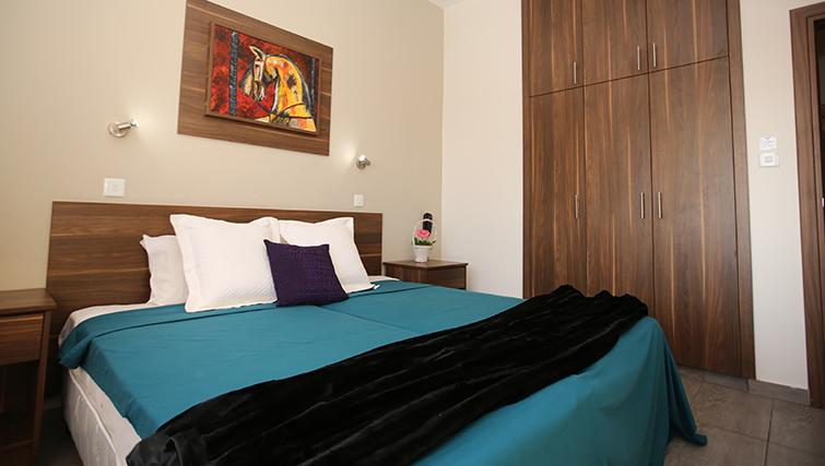 Comfy bedroom in Lucky Hotel Apartments