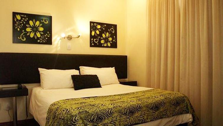 Bedroom at Premiere Classe Suite Apartments