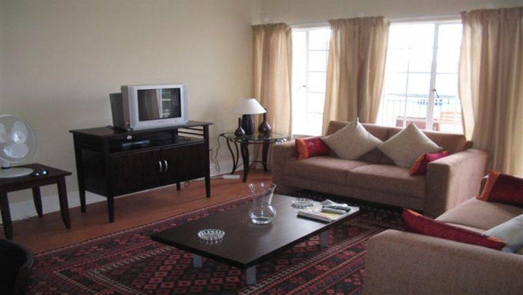Modest living room in 254 West Road South Apartments
