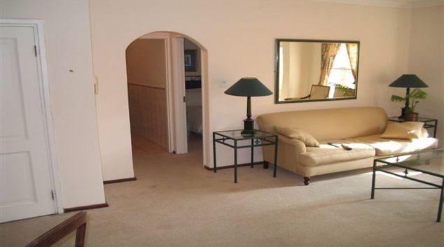 Sophisticated living area in Villa Via Apartments